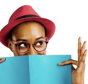 Person in a red hat reading a blue book