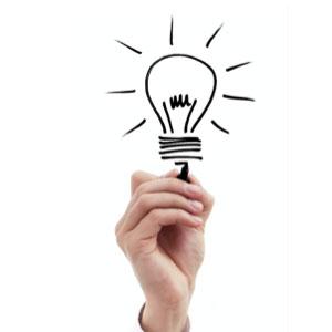 hand holding illustration of lightbulb