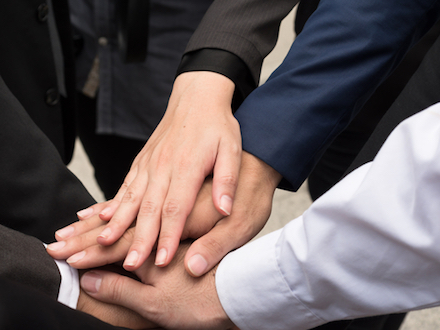 Hands in a circle indicating ethics
