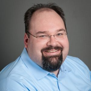 headshot of Greg Taylor