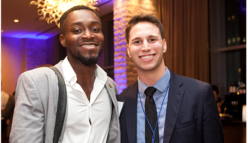 Two male PRSA members smiling into the camera