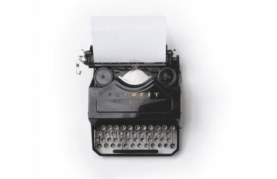 An overhead image of a black typewriter